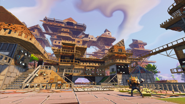 A huge wooden fort with multiple floors and rooms rising into the sky.